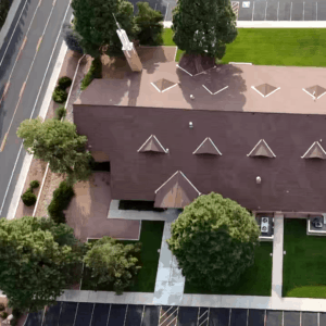 Property managment aerial photo of a church with lawns and trees